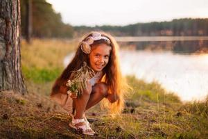 Happy beautiful little girl child kid in white dress outdoors photo