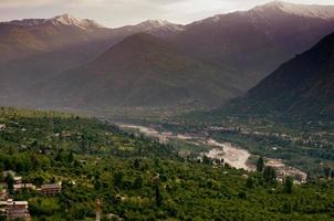 Evening view of Kulu valley with Himalaya range in background