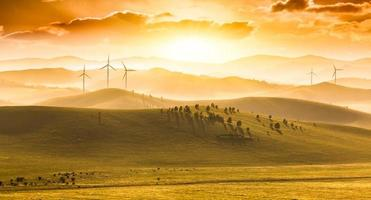 Mountains and grassland at sunset photo