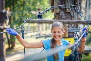 Girl in a climbing adventure park photo