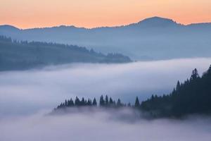 Majestic sunset in the mountains landscape. Carpathian, Ukraine photo