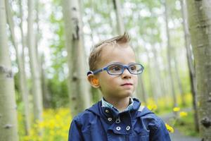 Portrait of cute little boy child outdoors on the nature