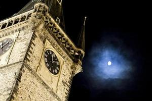 Old city town hall tower and the moon