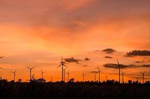 wind turbine at sunset photo