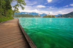 Wooden pathway on the coast of lake Bled in Slovenia