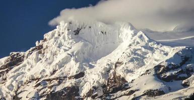 snow capped Antisana Vocano, Ecuador photo