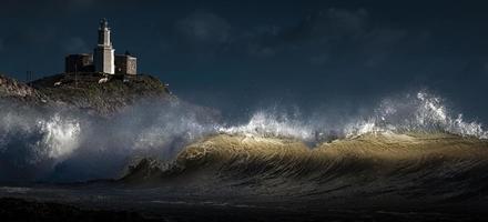 Light on a wave at Bracelet Bay photo
