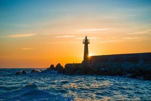 lighthouse under sunburst photo