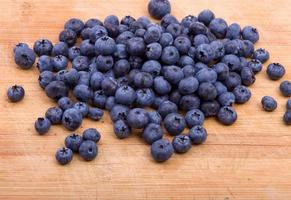 Blueberries on wooden texture background
