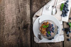 Chocolate pudding with berries photo