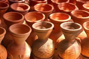Many handmade clay pots photo