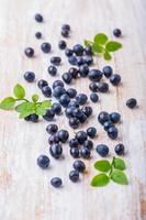 Blueberry on white wooden background