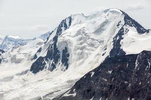 High mountain with glacier. Kyrgyzstan photo