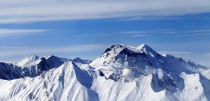 Panoramic view on winter mountains in haze photo