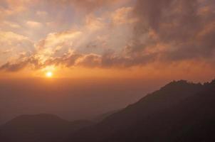 Sunrise silhouette mountains layer photo