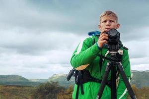 Photographer man in mountain photo