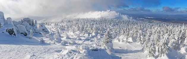 Panorama of mountains in winter in bright sunny day. photo