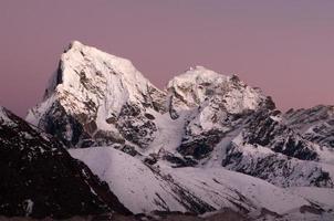 Rose-colored sunset on Nuptse slope photo