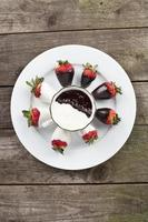 plate of strawberries with white and brown chocolate