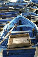 Blue fishing boats aligned in Essaouira