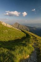 Amazing evening on ridge of the summer mountains