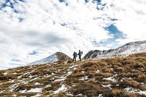 walking couple in carpathian mountains photo