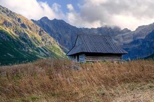 Mountain wooden hut photo