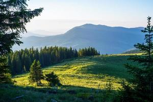 Blue sky and green hills photo