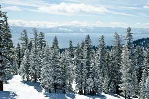 View of mountain range by Lake Tahoe on winter day