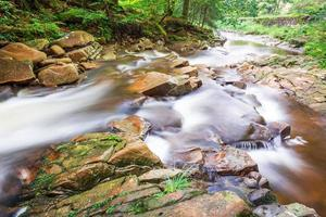 Mountain stream full of stones photo