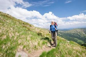 Woman walking on mountain terrain on a sunny day
