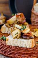 Fried cepes with bacon, garlic and rosemary photo