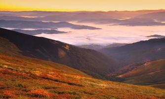 beautiful sunrise on the mountains photo