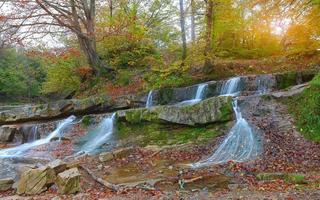 mountain stream in autumn at sunset photo