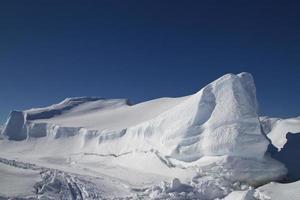 large flat frozen iceberg in the Southern Ocean Antarctic winter