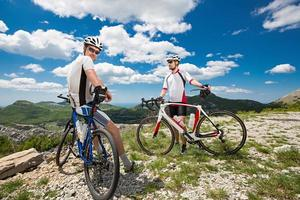 two cyclists in the mountains photo