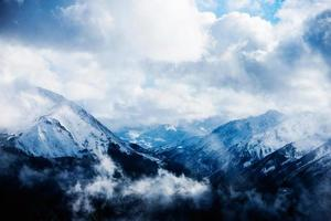 Clouds in a mountain range photo