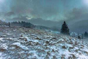 Snowstorm. Winter in the mountains photo