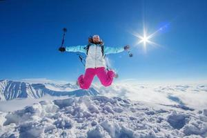 Hiker in winter Caucasus mountains photo