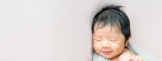 Asian newborn baby sleeping