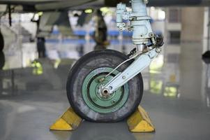 Close up of airplane wheel in an airfield