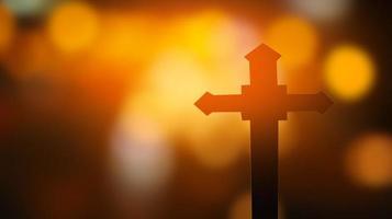 cruz sobre fondo bokeh