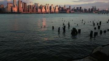 View of Manhattan Skyline on a summer evening over Hudson river