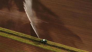 Aerial view:Irrigation system watering a farm field