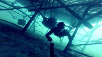 Freediver Exploring a Big Underwater Structure