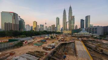 Sunrise Time lapse of a construction over looking the national landmark, Petronas Twin Tower in Kuala Lumpur