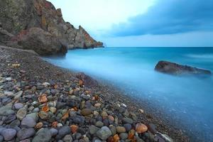 beach sea and mountains on a long exposure photo