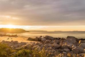 Ocean beach at sunrise photo