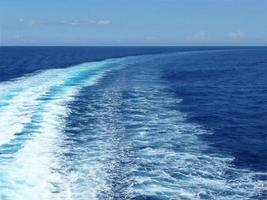 Wave traces on the blue ocean photo
