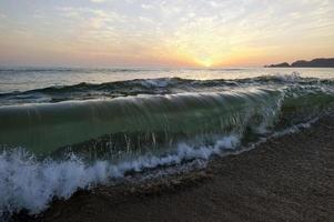 Wave Breaking on Beach Ocean Sunset